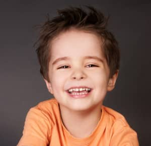 Cute Kid Showing Off His Cavity Free Smile