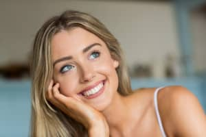 Smiling Woman Thinking about her Alternatives to Teeth Whitening